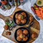 overhead view of cajun bbq sausage bites served in cast iron skillets