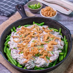 Cream Chipped Beef green bean casserole in a cast iron skillet
