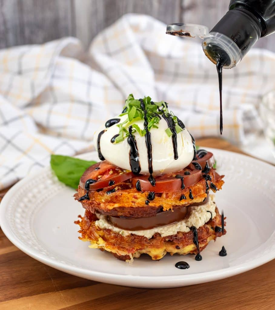 Drizzling balsamic reduction on the Buratta Chaffle