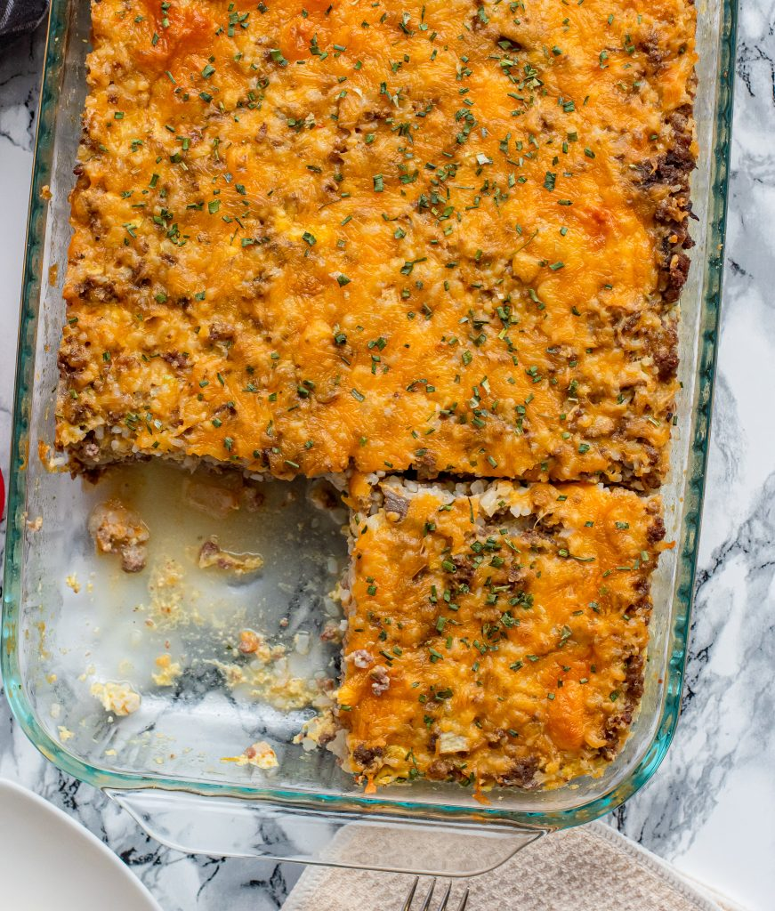 low carb cheeseburger casserole with a portion removed
