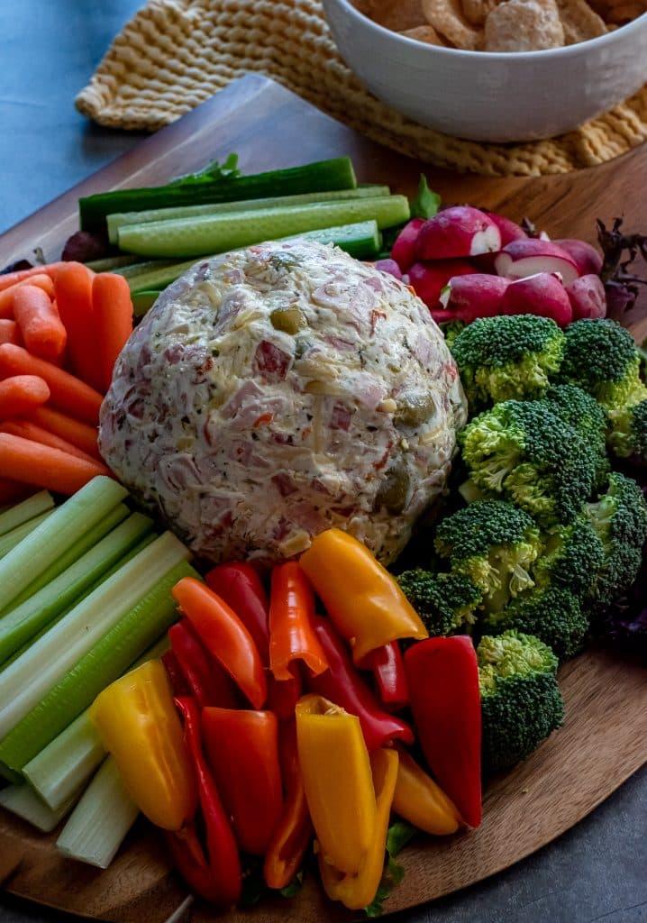 muffuletta dip with fresh veggies and pork rinds