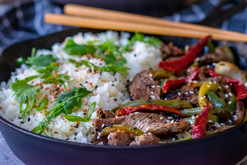 Low carb pepper steak in cast iron skillet with chop sticks