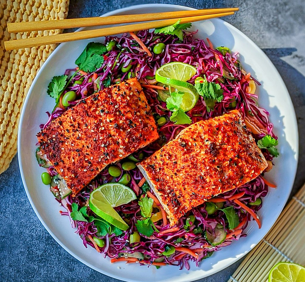 Asian red cabbage slaw with creamy cilantro lime dressing topped with salmon