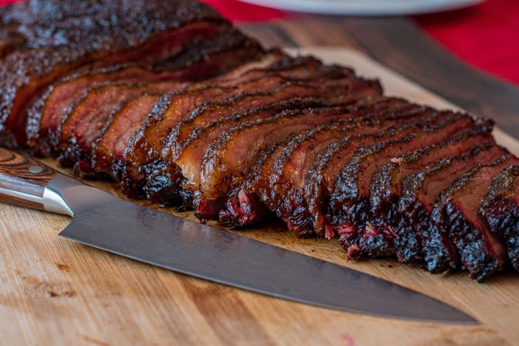 sliced texas brisket cooked on pellet smoker