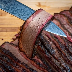 slice of texas brisket very tender with beautiful smoke ring