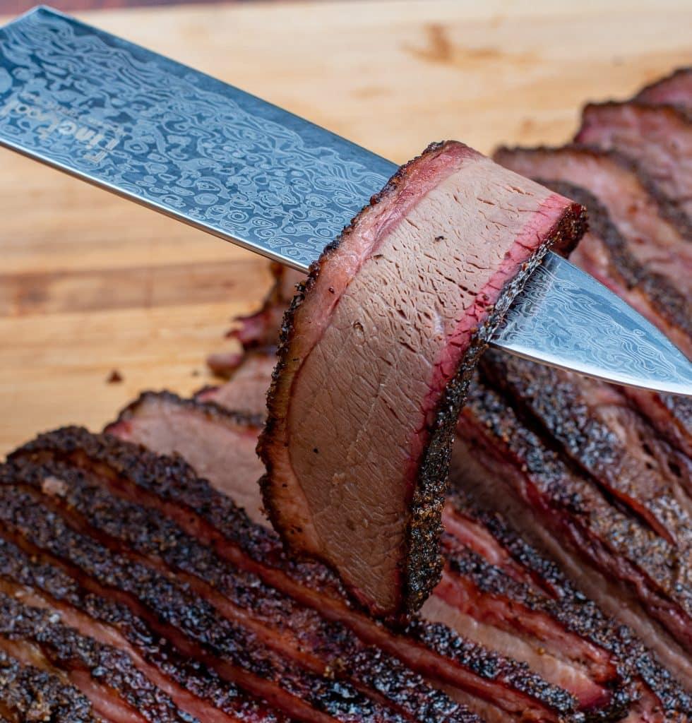 slice of texas brisket very tender with beautiful smoke ring