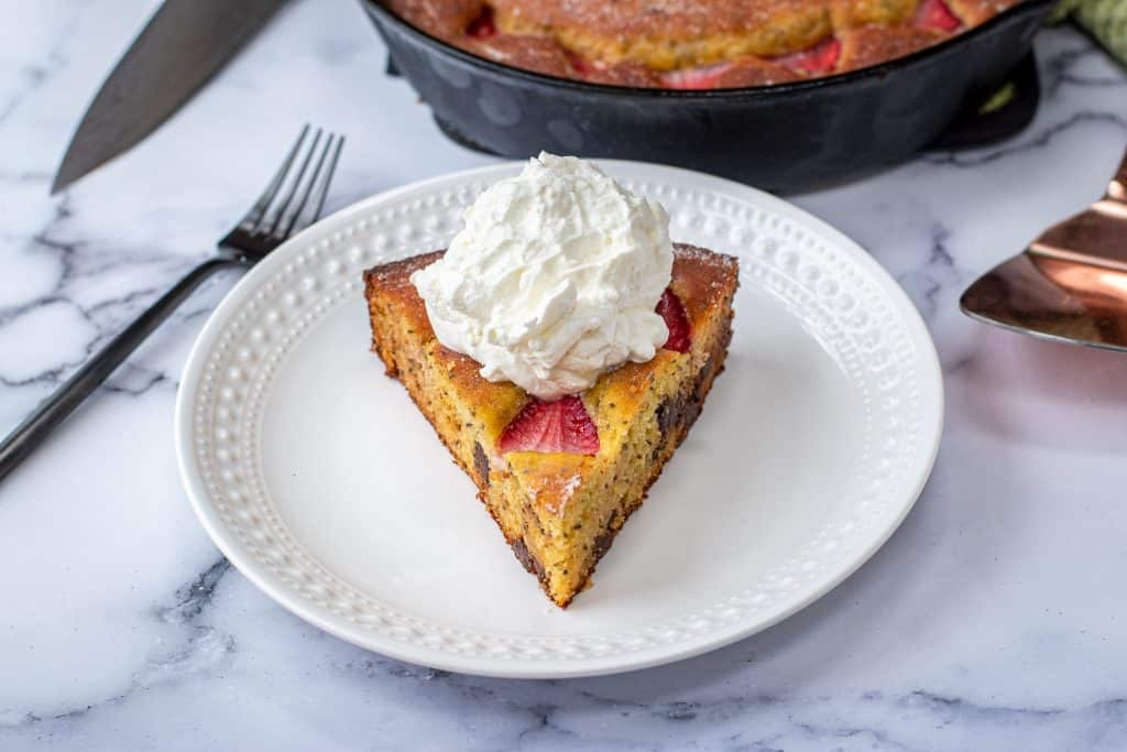 low carb strawberry olive oil cake topped with homemade whipped cream