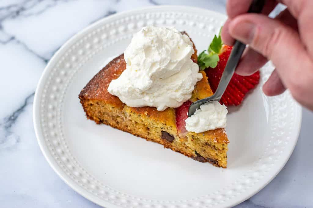 Strawberry Chocolate Olive oil cake topped with whipped cream