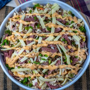 low carb reuben coleslaw topped with Russian dressing
