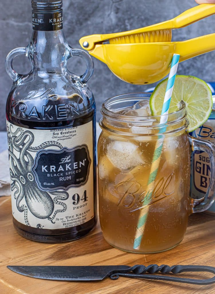 squeezing fresh lime juice into a keto dark and stormy
