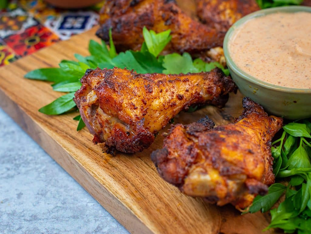 chili rubbed wings dipped in chipotle ranch dressing