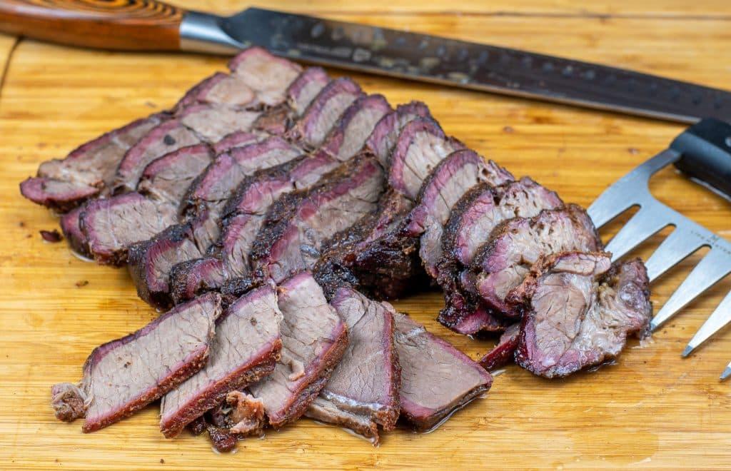 sliced smoked chuck roast on a cutting board