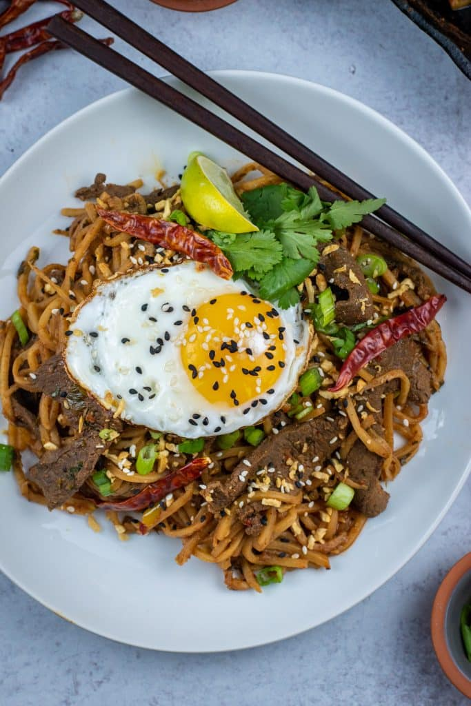 Low carb beef lo mein topped with a fried egg