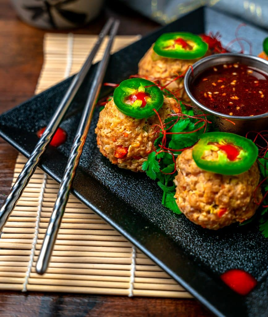 low carb thai chicken meatballs served on a square black plate