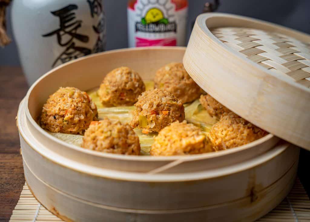 steamed chicken meatballs in a bamboo steamer