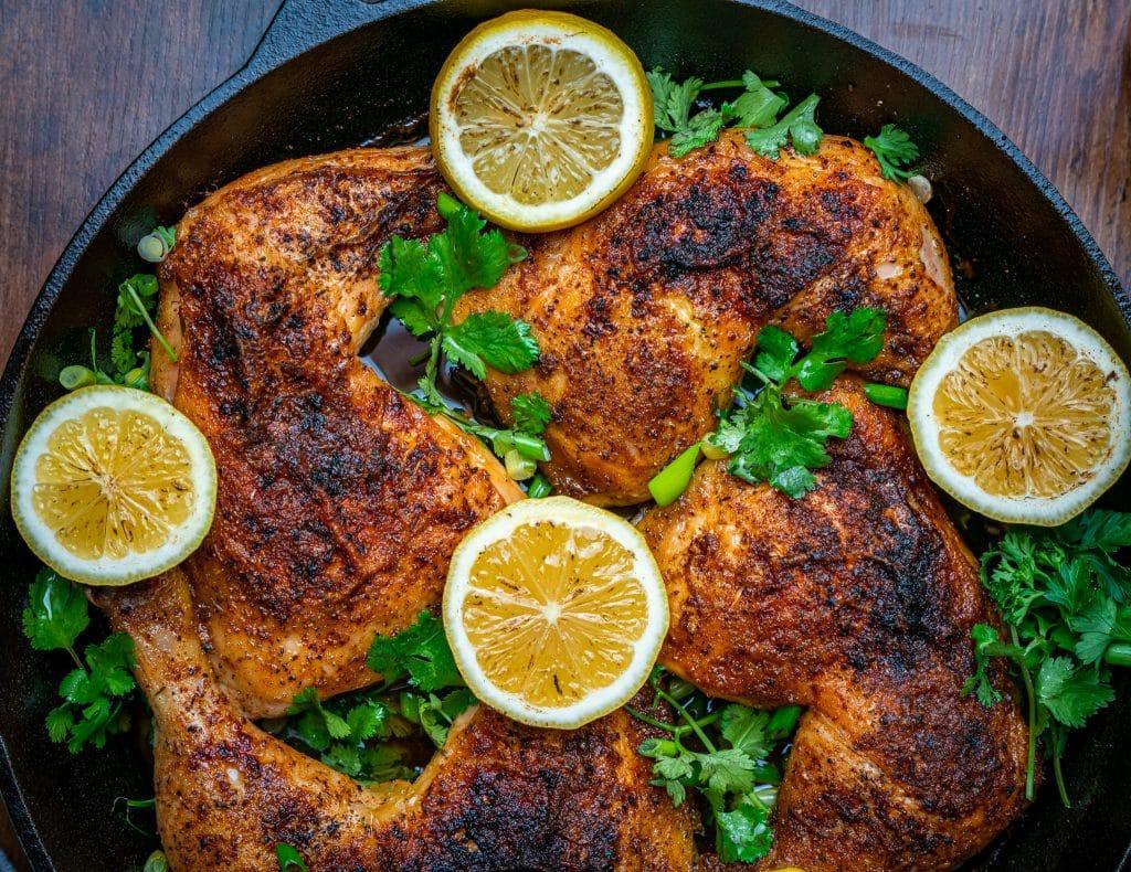 Lemon Pepper Chicken Leg Quarters in the oven Cast Iron skillet
