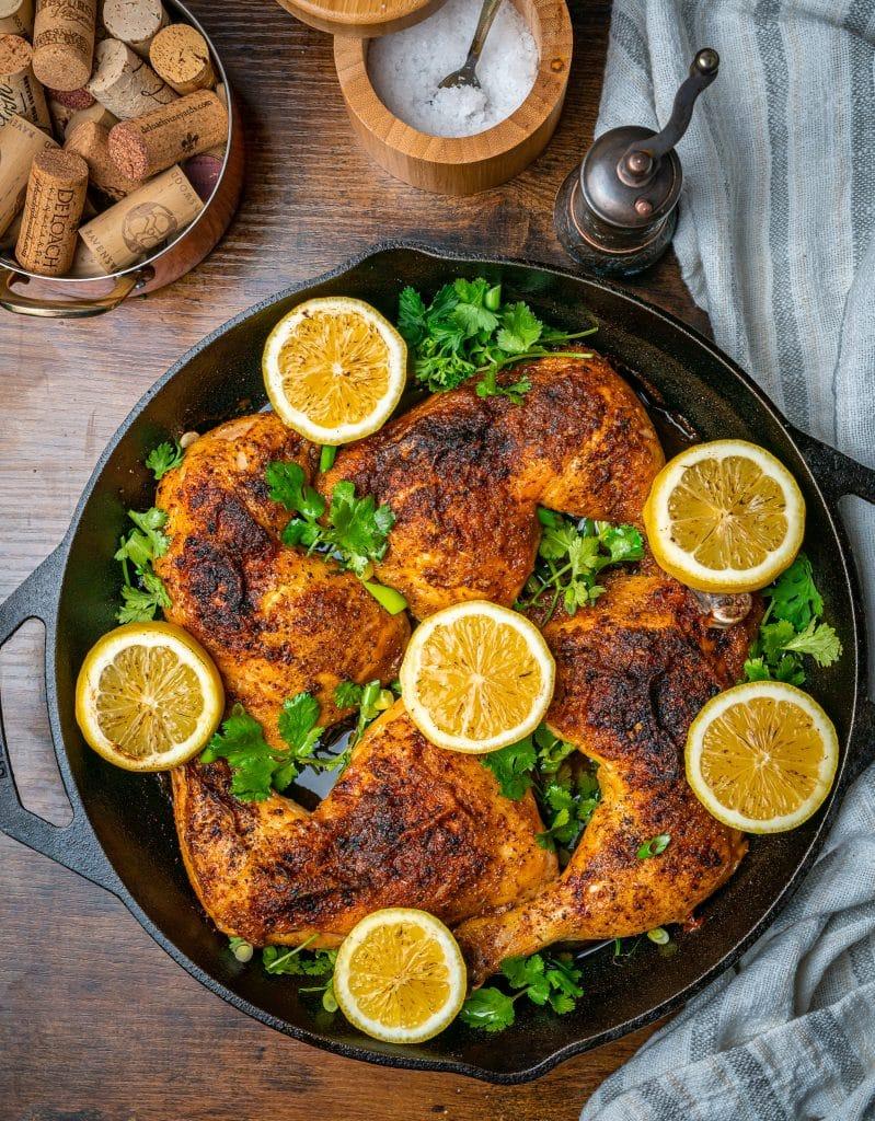 overhead of Lemon Pepper Chicken Leg Quarters in the Oven