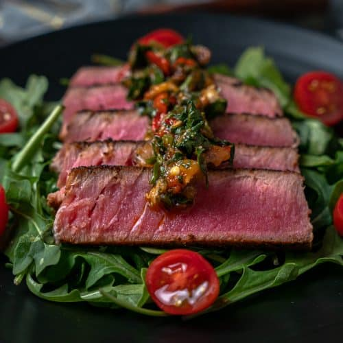 sliced blackened tuna fanned out on a plate