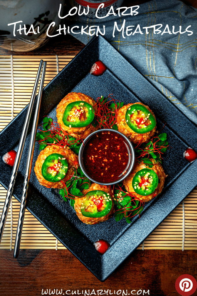 thai chicken meatballs garnished with chili threads and sliced jalapeños