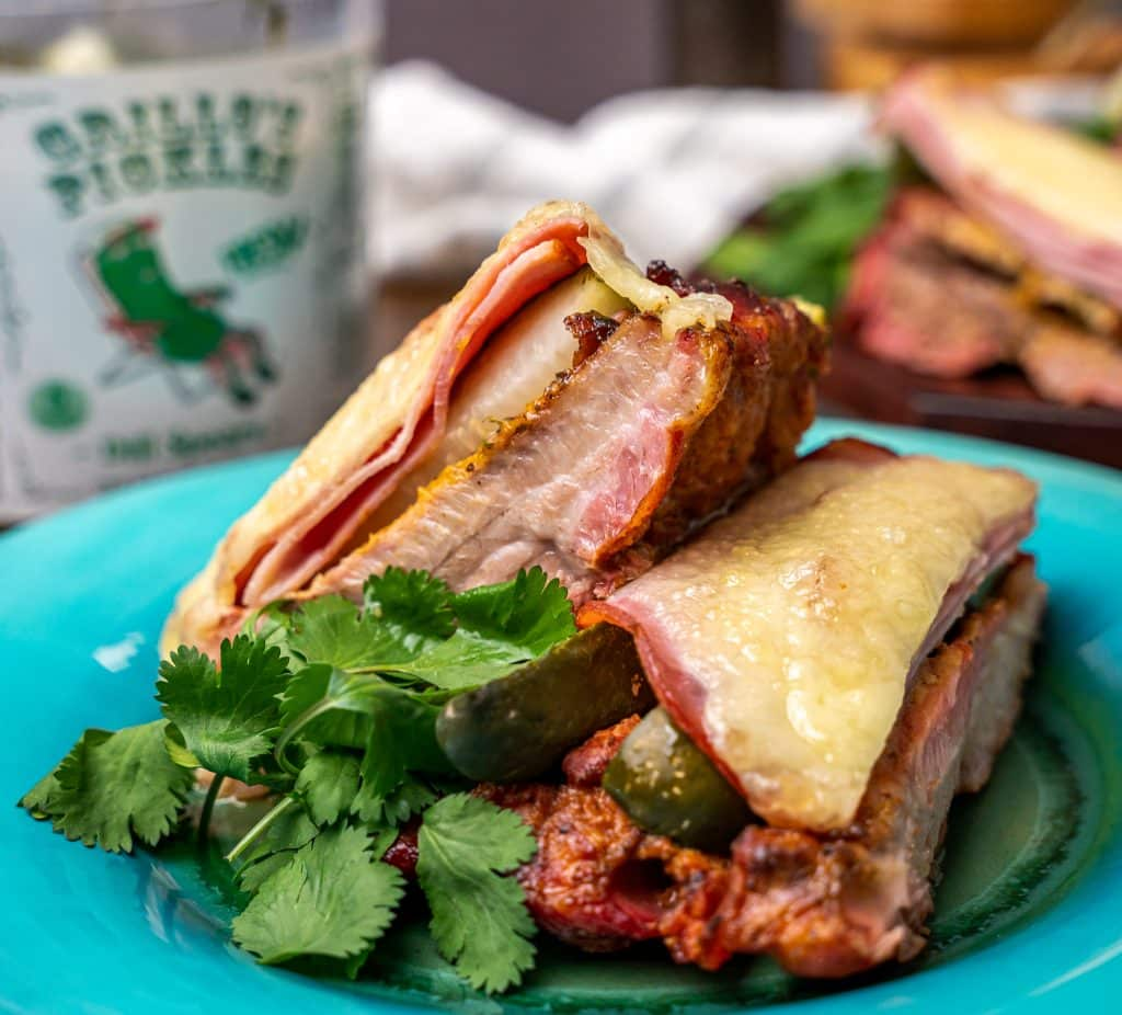 Cubano ribs topped with ham, Swiss and pickles