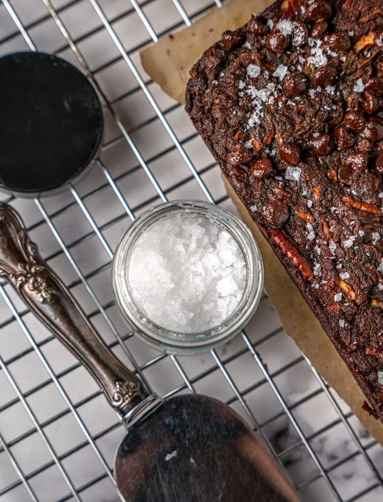 Flaky sea salt on top of chocolate pecan zucchini bread