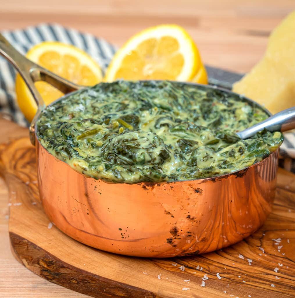 steakhouse style keto creamed spinach with sliced lemons